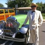 A VERY dapper collector by his patriotic car