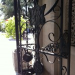 The original ironwork gate to the porte cochere has such amazing detail