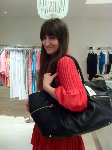 Even if you don't need it for diapers: Rebecca Wolf of GirlsGoneChild.net looks great modeling one of Rosie Pope's diaper bags