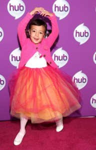 Aubrey Anderson-Emmons of Modern Family pirouettes on the red carpet