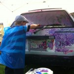 "Painting a car at Beverly Hills' biannual ""Affaire in the Gardens"""