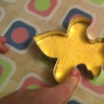 Critter chose a Fleur de lis shape from a big box of cookie cutters to create the decoration on BHDad's treasure box gift