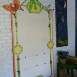 Step Four of the Critter Art Installation display board - thread ribbon through grommets and hang with a Floret nail kit. I let the Critter choose how to pin the butterflies and crystals, and frankly his design was better than what I planned ;)