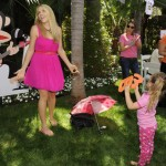 Busy Phillips and her little girl frolic in the grass with Julius