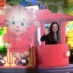 I missed no opportunity to have fun with the props and characters of the PBS Annual Meeting 2012 - here in trolly with Daniel Tiger