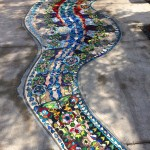 immediate design lover's eye candy - ebullient mosaics in the sidewalk outside the JW Marriott in Downtown Austin
