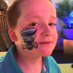 He's not usually a fan of the facepainting thing, but he loved this tatoo - at the #Dinotrux premiere #StreamTeam