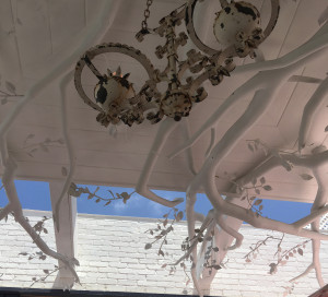the canopy over the patio at Au Fudge against the blue summer sky