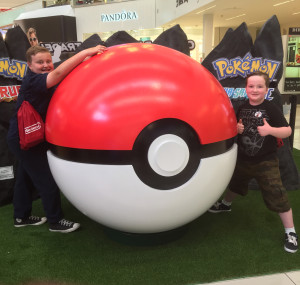 The Critter (right) and BFF Big J show the love for Pokemon at the Nintendo 3DS Kid for a Day Event